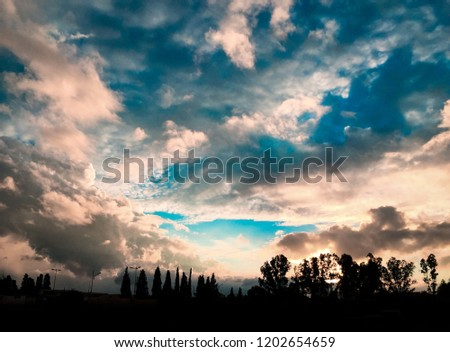 landscape sunset. A blue sky with clouds #1202654659