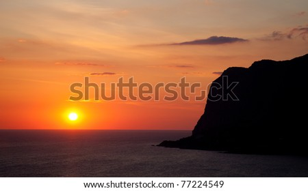 Landscape. Sunset over the mountains and the sea
