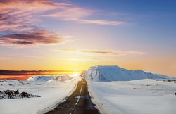Landscape the road in winter, road trip on the country road in sunrise at Iceland
