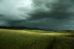 Landscape under light and shadow from a heavy storm. Semonkong. Lesotho
