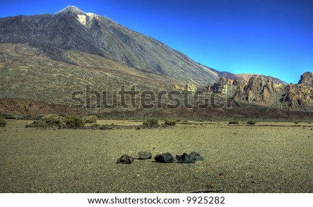 Landscape view across a crater bed towards the peak of Teide at the Teide National Park, Tenerife