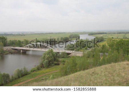 Landscape view from a hill over a bridge over a river