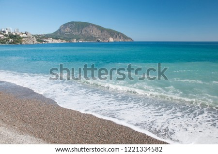 Landscape view of a pebble beach at Gurzuf resort in Crimea with Ayu-Dag or Bear mountain in the background, Russia