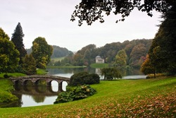 Landscape view of an English garden and lake.