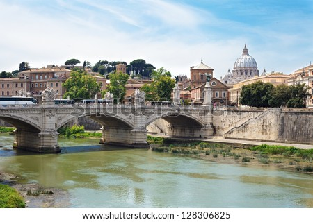 Landscape view of bridge over Tiber and St. Peter Cathedral