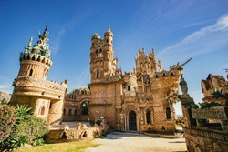 Landscape view of Castillo de Colomares Benalmadena, Malaga, Spain with its ornate architecture and turrets against a sunny blue sky
