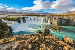 Landscape View Of Godafoss Waterfall Under Clear Blue Sky On Skjalfandafljot River, Northern Region of Iceland