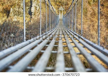 Landscape view of Long Steel Suspension bridge above the river.  Nobody  Foto stock ©