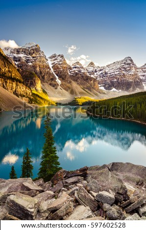 Landscape view of Moraine lake and mountain range at sunset in Canadian Rocky Mountains