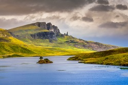 Landscape view of Old Man of Storr rock formation and lake, Scotland, United Kingdom