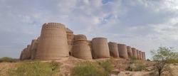 Landscape view of remote impressive ancient Derawar fort with its forty brick bastions in the Cholistan desert, Bahawalpur, Punjab, Pakistan
