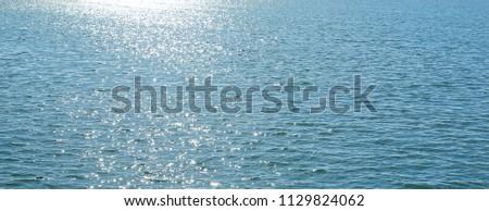 Landscape view of Sparkle sunshine reflection on the blue sea.