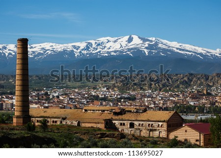 Landscape view of the town of Guadix,Spain and the snow capped Sierra Nevada Mountains
