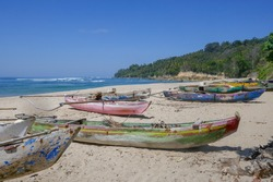 Landscape view of Wanokaka beach with colorful outrigger fishing boats, Lamboya, Sumba island, East Nusa Tenggara, Indonesia
