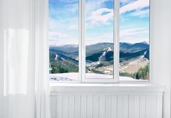 Landscape view through modern window in room