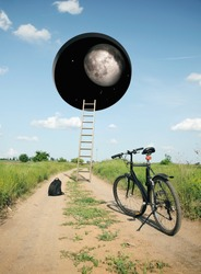 Landscape with a bicycle on the road and a hole in the sky leading to another world.  Photo with 3d rendering element.  Elements of this image furnished by NASA.