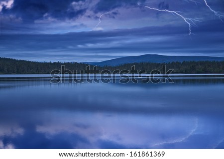 Landscape with a night thunder-storm on the lake in national park Sarek in Sweden.
