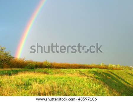 stock-photo-landscape-with-a-rainbow-and-green-grass-48597106.jpg