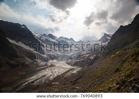 landscape with a view of the mountains and a melting glacier #769040893