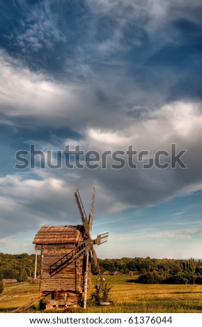 landscape with a windmill against the blue sky
