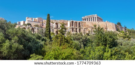 Landscape with Acropolis hill, Athens, Greece. Famous Acropolis is top tourist attraction of Athens. Scenic panoramic view of Ancient Greek ruins in Athens city center. Scenery of old Athens landmark.