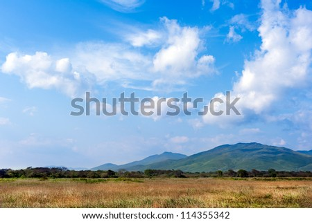 landscape with beautiful clouds and mountain views,  real scene without any light effects