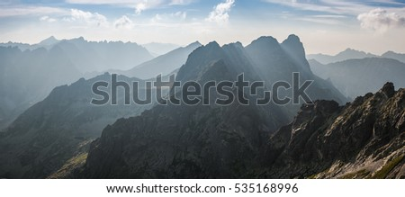 Landscape with beautiful mountain ranges, sky with clouds over highlands #535168996