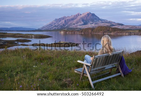 landscape with blond woman...
