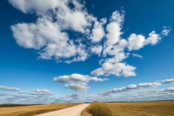 landscape with Blue sky background and big white tiny stratus cirrus striped clouds