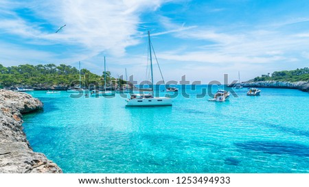 Landscape with boats and turquoise sea water on Cala Mondrago, Majorca island, Spain