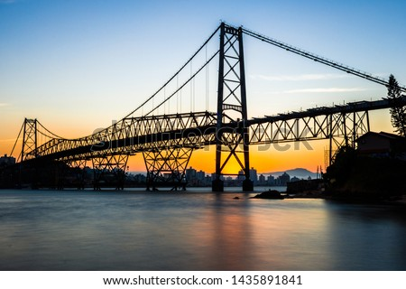landscape with cable-stayed iron bridge at sunset with seascape with blue and golden sky, Hercilio Luz Bridge Florianopolis - Santa Catarina - Brazil