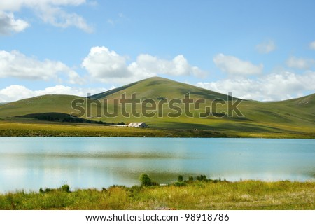 Landscape with clouds, mountain and lake  in Georgia.