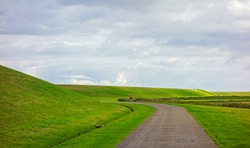 Landscape with dike along the Wadden sea in the Netherlands