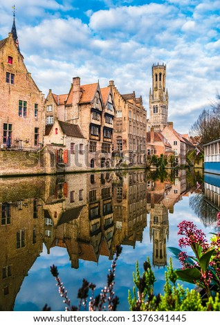 Landscape with famous Belfry tower and medieval buildings along a canal in Bruges, Belgium Сток-фото ©