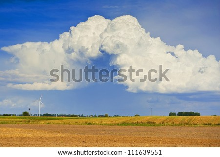 Landscape with fields and beautiful clouds