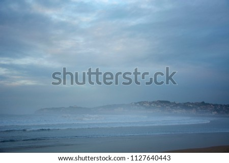 Landscape with fog, cloudy sky and cold colours #1127640443