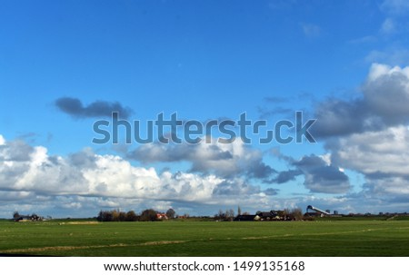 Landscape with green field, farm and white clouds on blue sky.   #1499135168