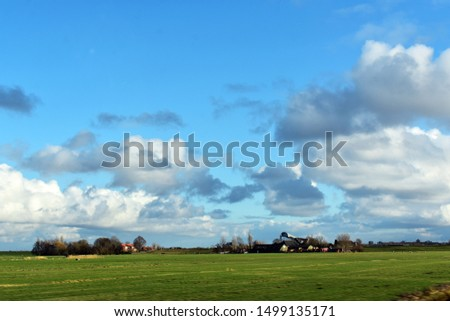 Landscape with green field, farm and white clouds on blue sky.   #1499135171