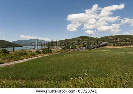 Landscape with highway near Arezzo (Tuscany, Italy) at summer