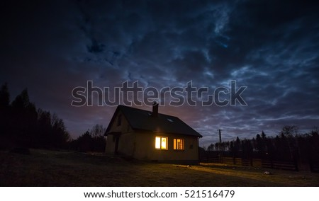Landscape with house at night under cloudy sky. Spooky landscape with house in night. #521516479
