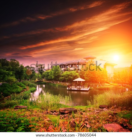 Landscape with house on lake with sunset