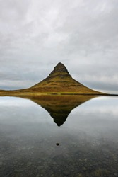 Landscape with Kirkjufell mountain in the background. Amazing mirror effect on the north coast of Iceland Snaefellsnes peninsula. Natural travel destination.