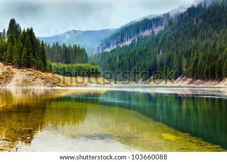 Landscape with lake Galbenu in Parang mountains in Romania #103660088
