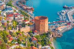Landscape with marina and Kizil Kule tower in Alanya peninsula, Antalya district, Turkey