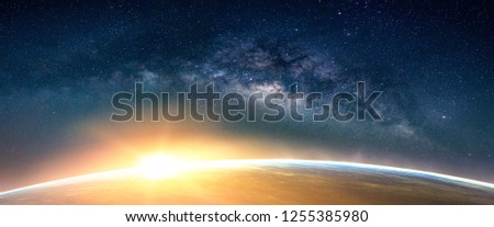 Landscape with Milky way galaxy. Sunrise and Earth view from space with Milky way galaxy. (Elements of this image furnished by NASA) #1255385980