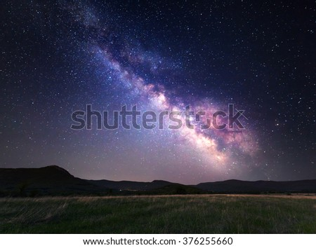 Landscape with Milky Way. Night sky with stars at mountains. #376255660