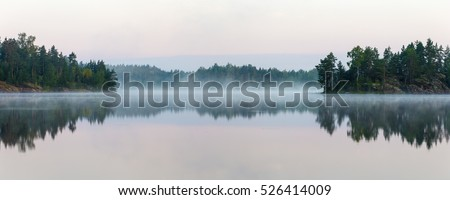 landscape with morning fog in...