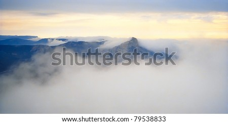 Landscape with mountains and mist.