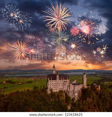Landscape with Neuschwanstein castle and beautiful holiday fireworks in majestic sky