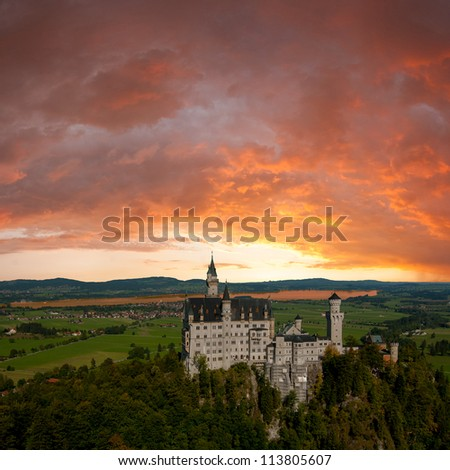 Landscape with Neuschwanstein castle, majestic clouds on background